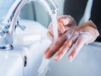 Washing hand at home.