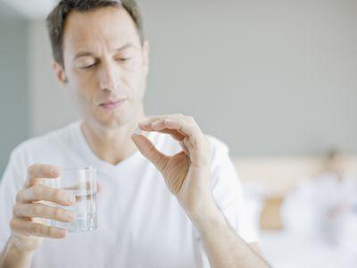 Man holding pill medication