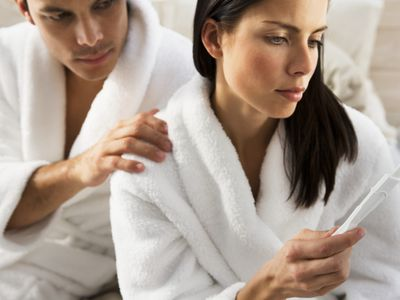 Couple looking at a pregnancy test