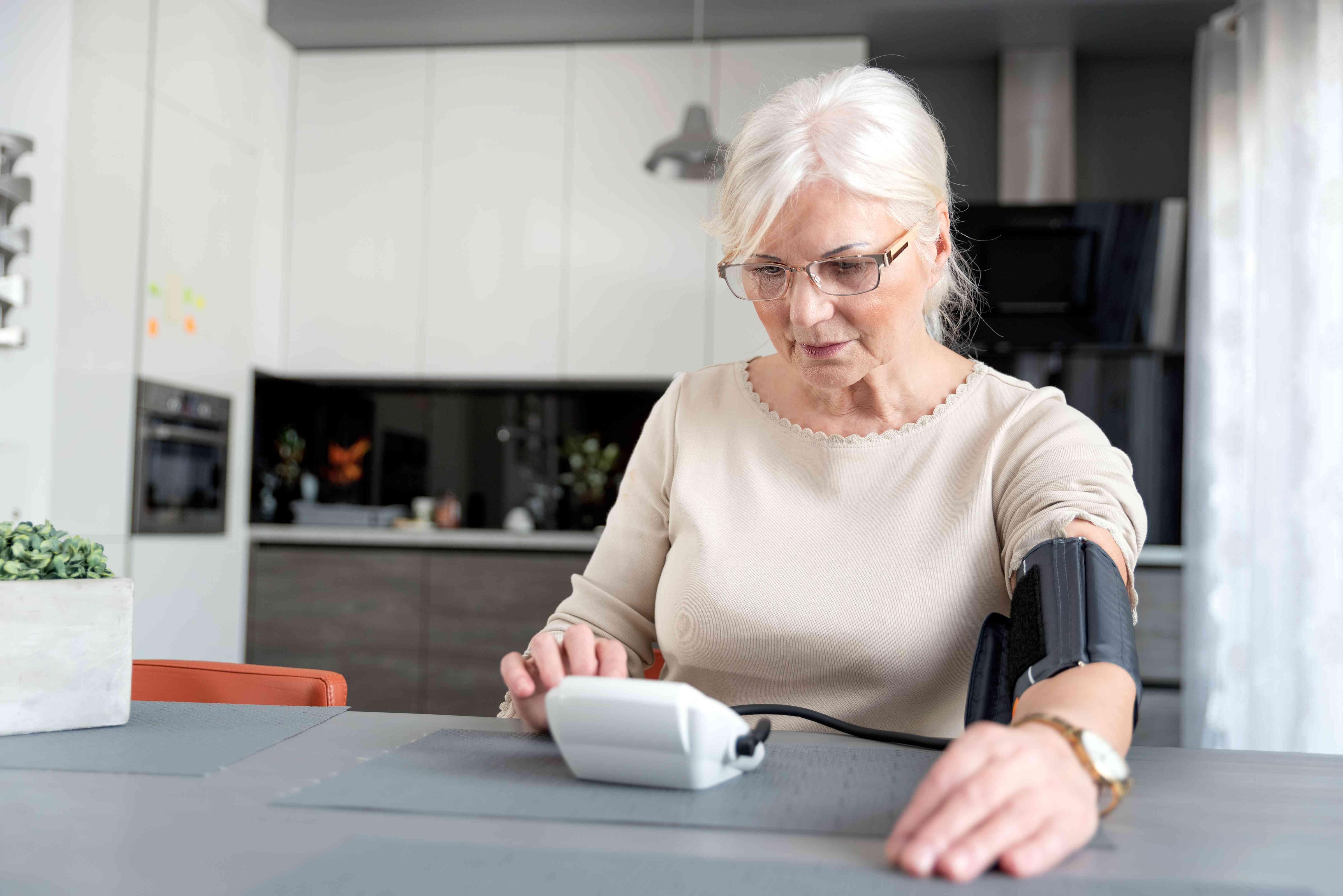 Senior Woman Checking Blood Pressure At Home