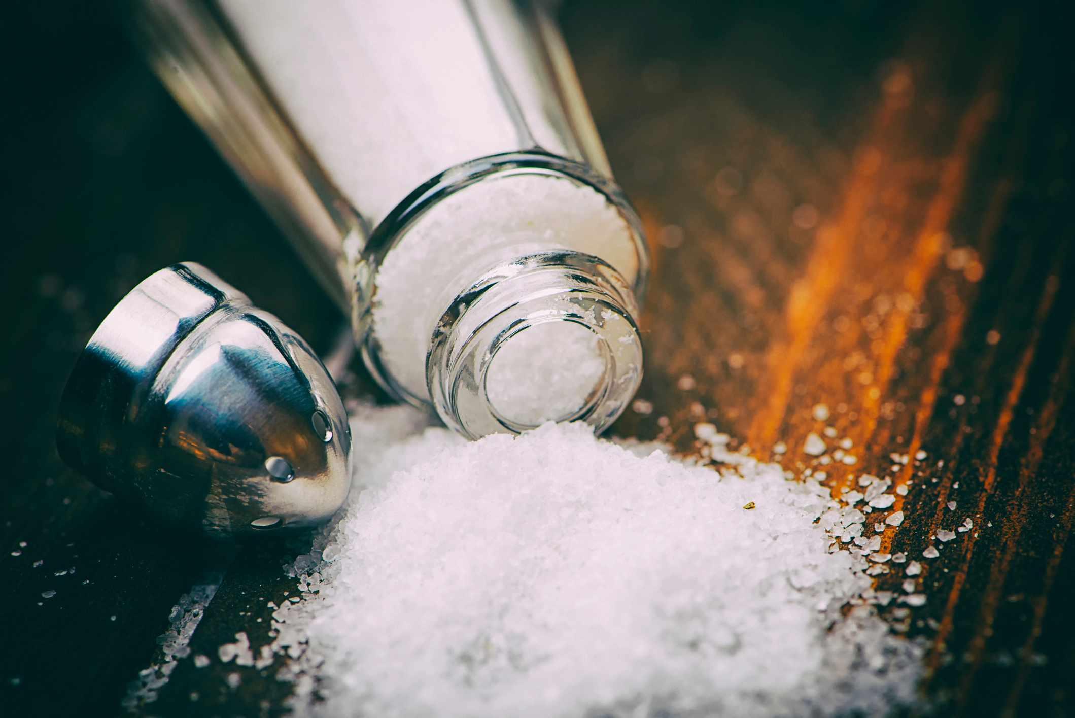 Spilt over salt shaker on table