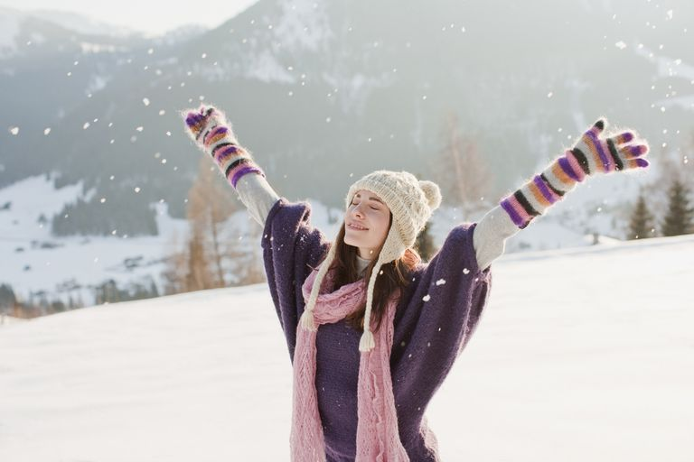Woman with arms outstretched in snow