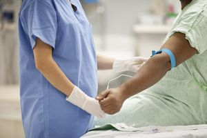 Nurse taking blood from patient in hospital