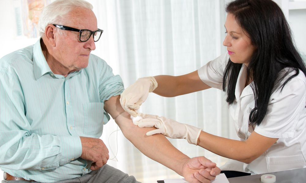 Blood sampling by an older man