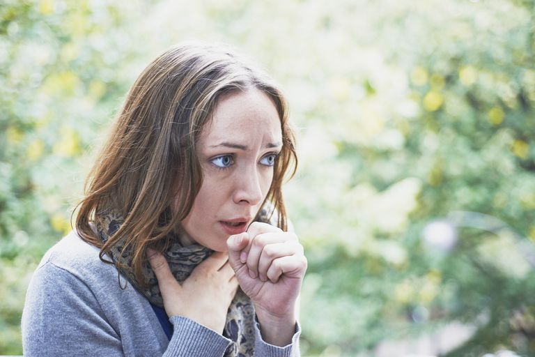 Woman with cough and sore throat