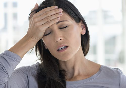 A woman suffering from a migraine.