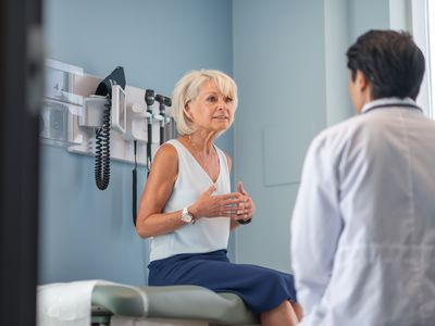 Mature adult woman in medical consultation with male doctor