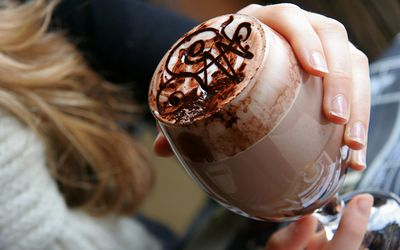Woman holding glass of hot chocolate