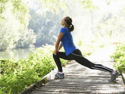 A mature woman stretching before a run