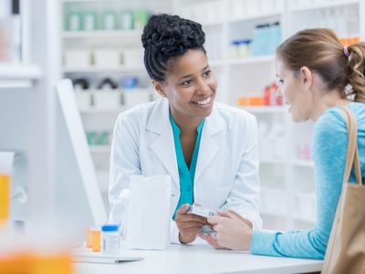 Woman discussing anti-epileptic drug options with a pharmacist
