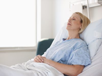 a female patient laying in hospital bed