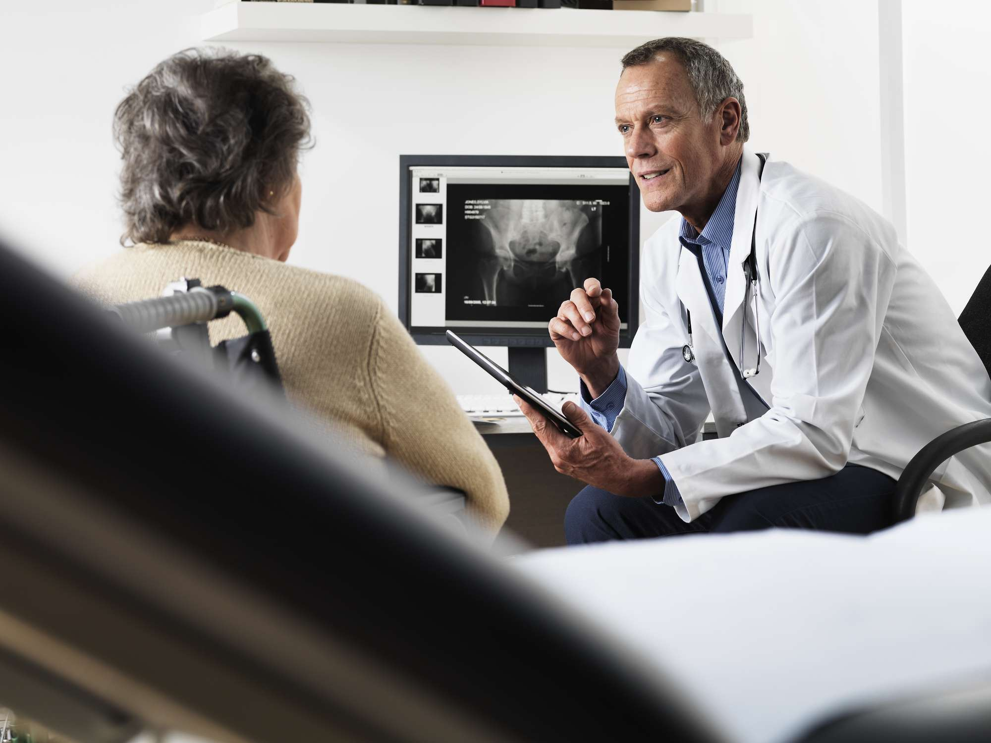 A doctor talking with his patient