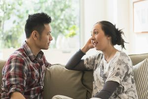 Couple talking on sofa in living room