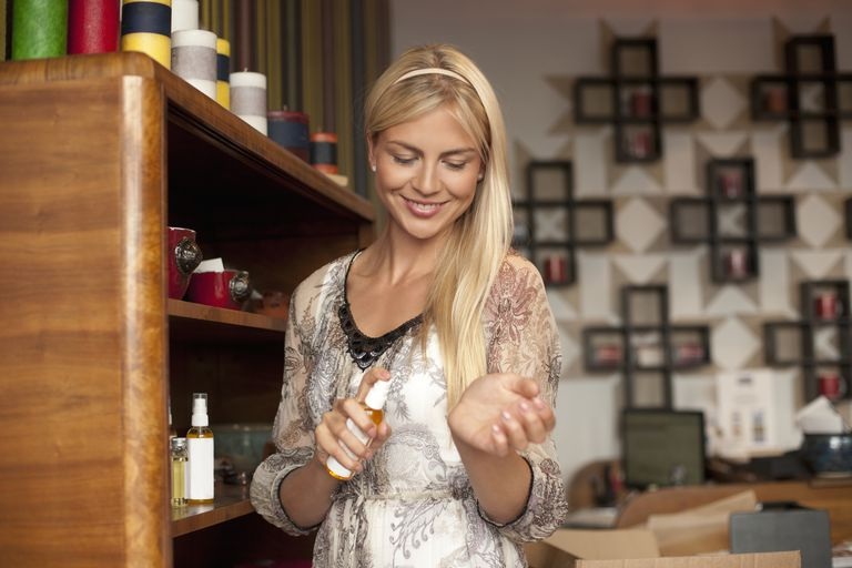 young woman trying perfume