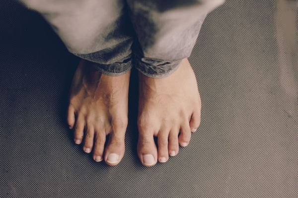 Crop view of young man's feet