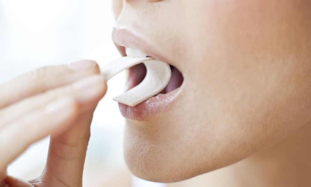 Woman chewing xylitol gum