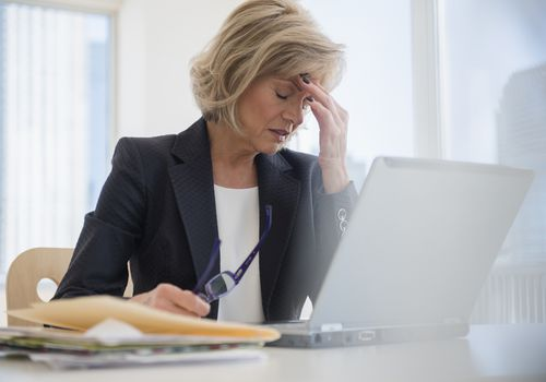 A woman at work suffering from a nummular headache