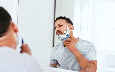 Young Black man shaving