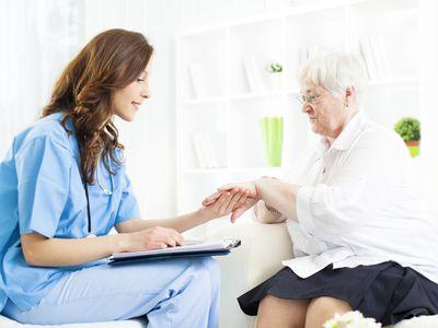 Nurse checking skin on older woman