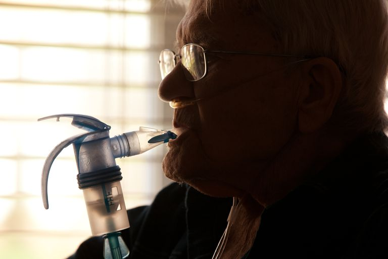 Elderly Man Using Nebulizer