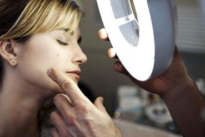 woman being looked at by a dermatologist