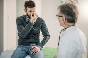Man talking with doctor