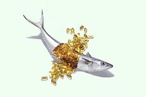 Fish Oil Bursting From a Whole Fresh Mackerel. - stock photo