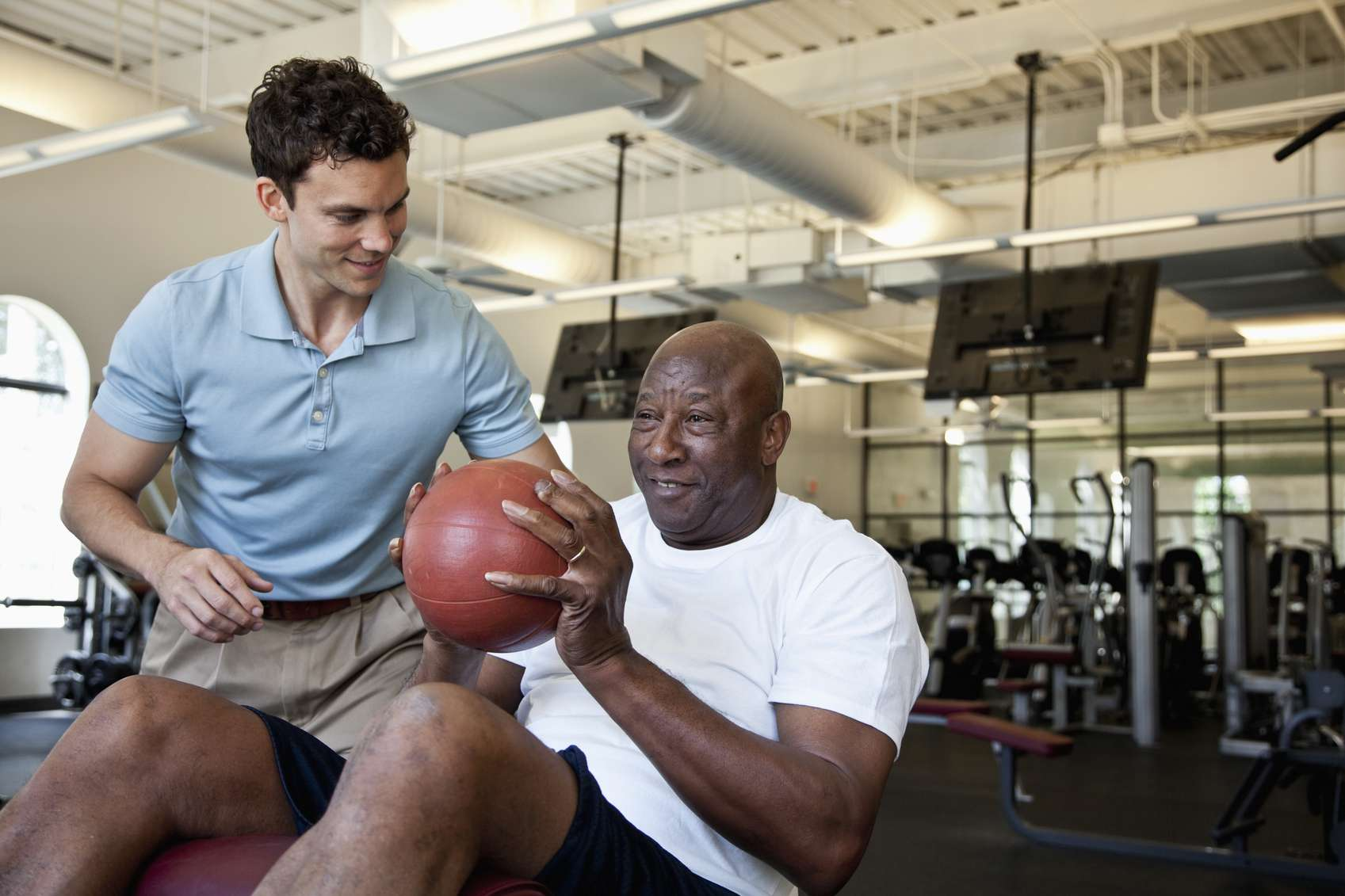 Man doing physical therapy at a gym