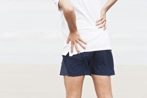 a male jogger having pain in his left hip