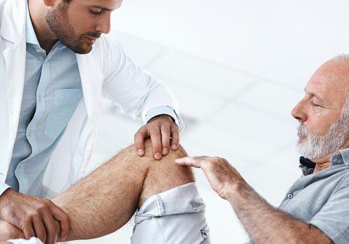 Senior man having medical exam.