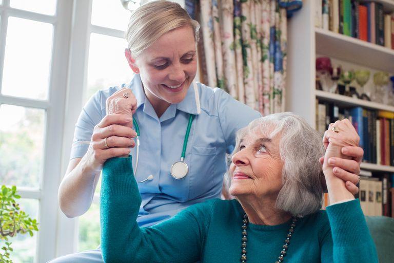 nurse working with an elderly patient