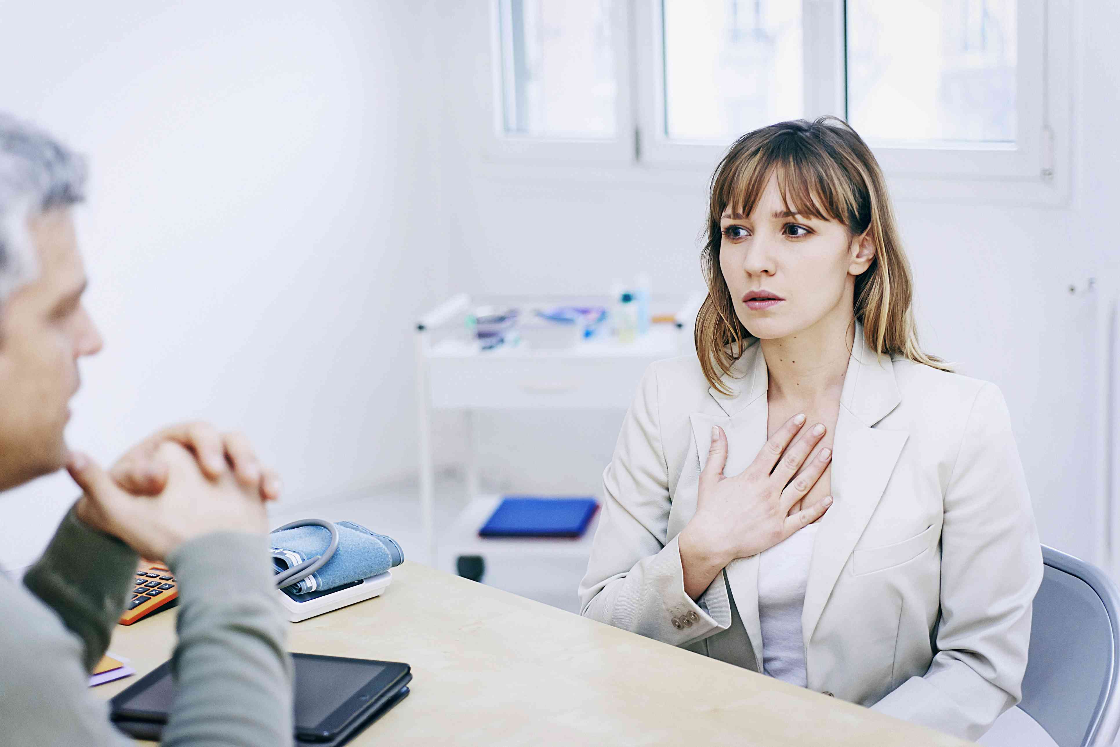 Patient consulting doctor for breathing difficulties