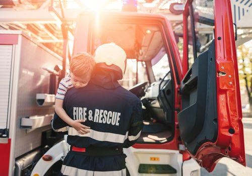 Firefighter saving little boy