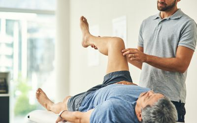 a physical therapist working with a patient