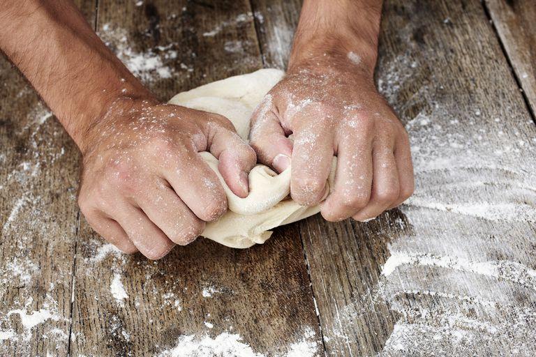 Man kneading dough