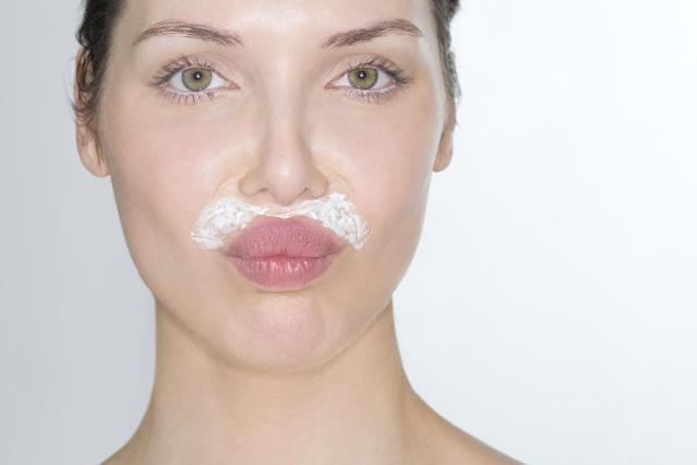 Woman bleaching facial hair