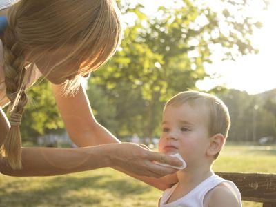 Parent assists child who has spit up