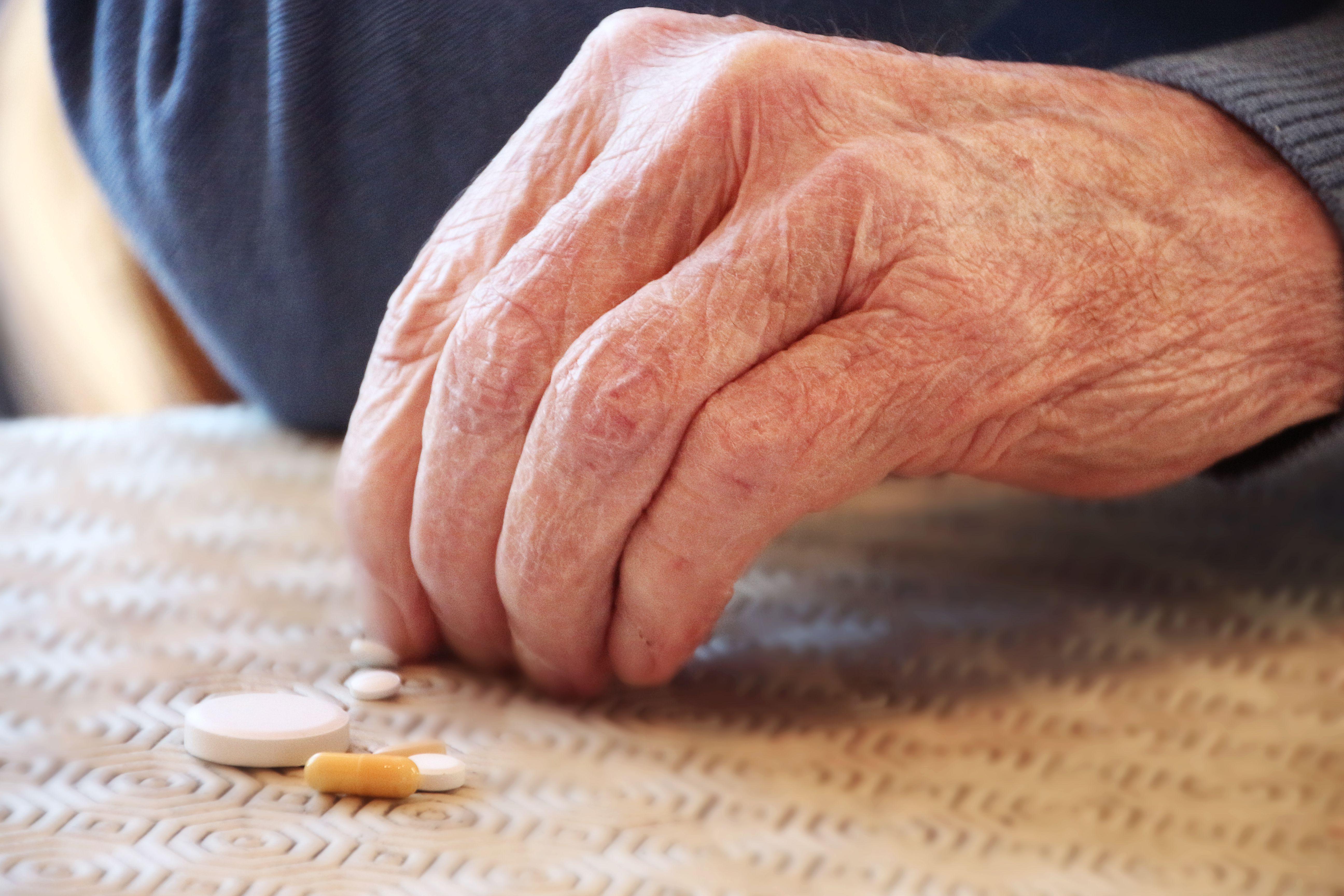 Senior man taking his pills