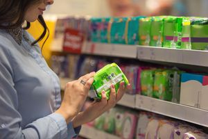 Woman looking over sanitary napkin packages