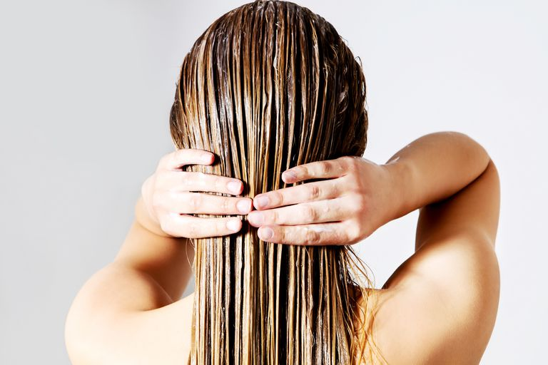 Woman with hair oil treatment