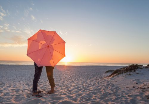Couple behind umbrella