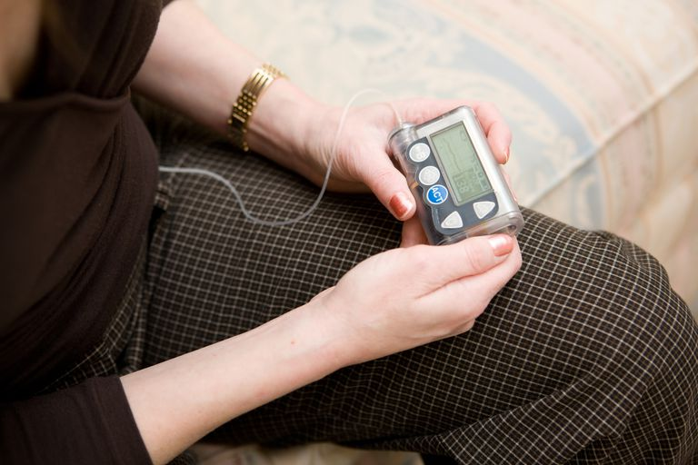 Woman checking her insulin pump