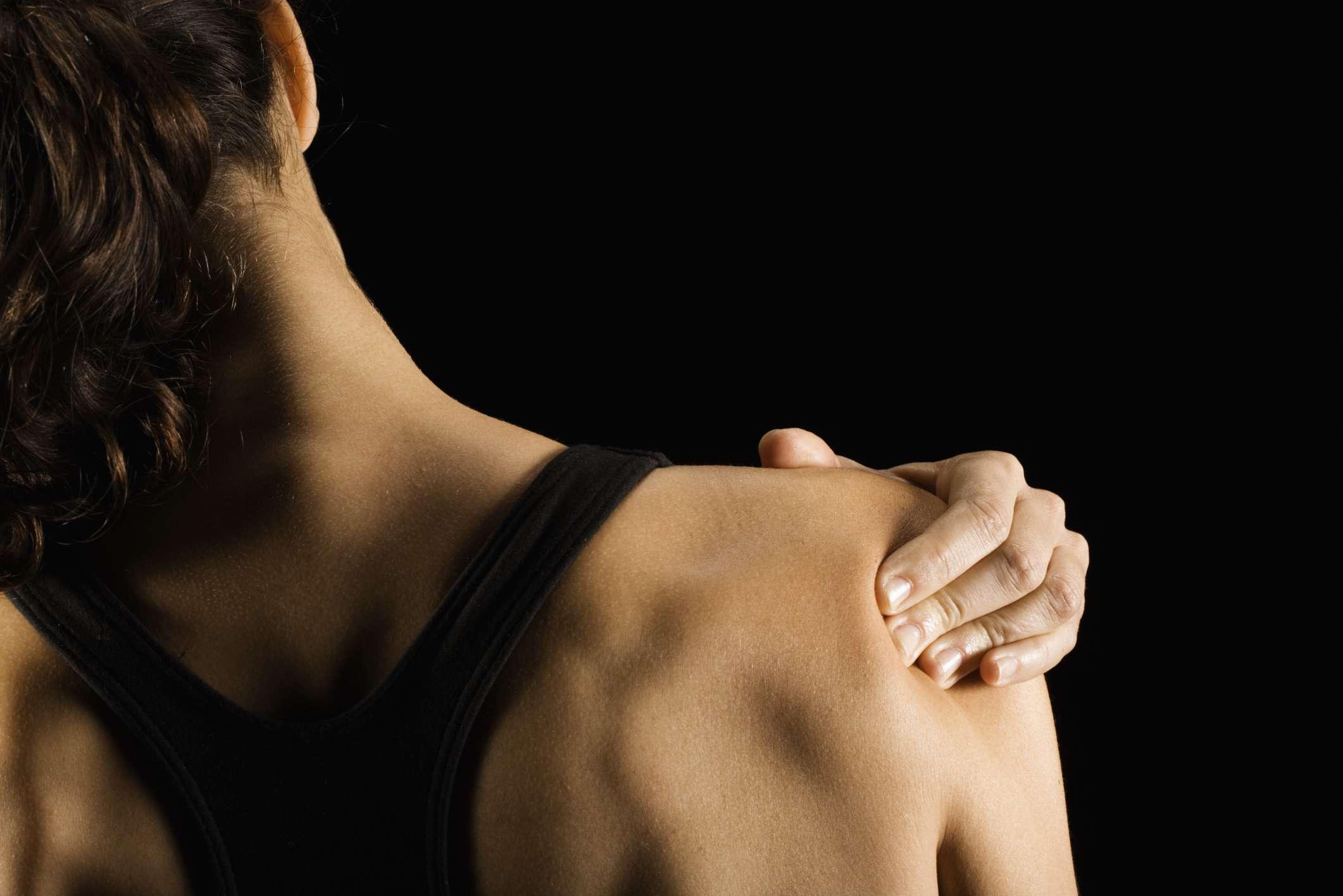 Women rubbing shoulder pain