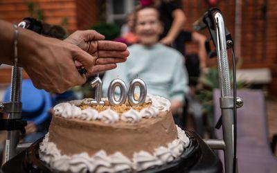 Older adult celebrating 100th birthday.
