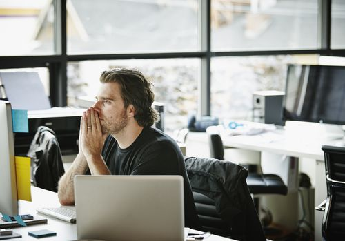 Man in office sitting by a computer