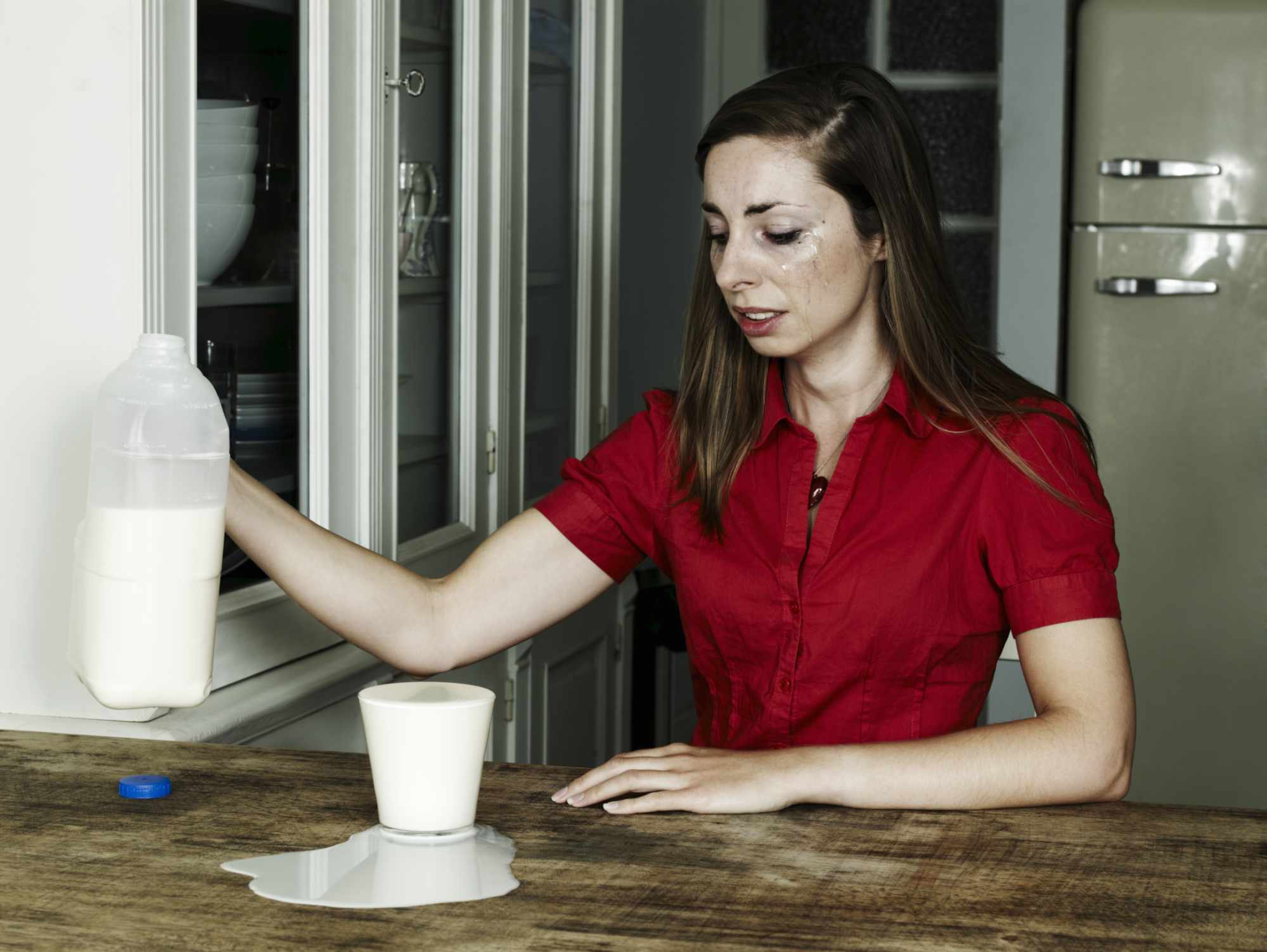 Woman accidentally pouring too much milk