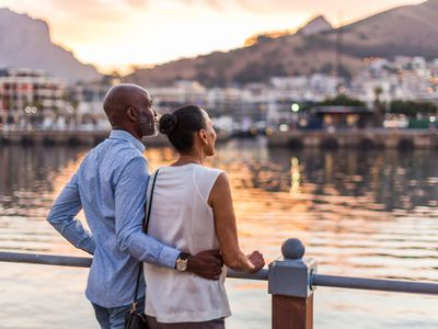 Couple looking at sunset at Cape Town waterfront