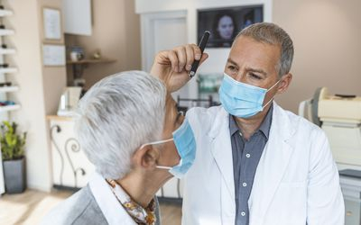 a doctor examining a patient's eye