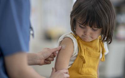 Little girl receiving a vaccine.