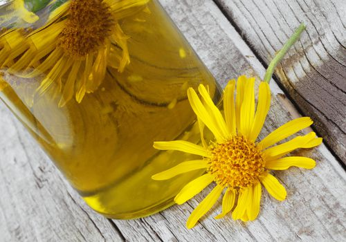 Arnica flower and oil